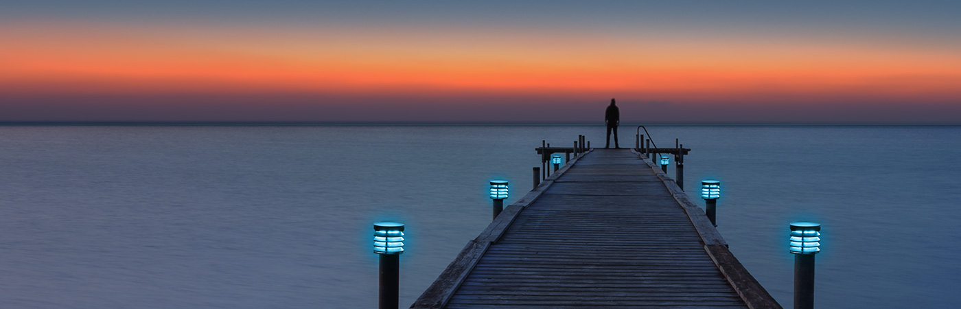 Man standing at end of a jetty